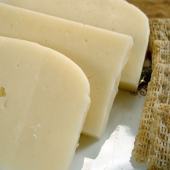 Havarti Cheese is a milder version of Tilsit Cheese. It is a rindless, semi-firm cheese made from cow's milk. The cheese is a pale yellow colour with tiny holes. It is very pliable, almost rubbery. http://www.cooksinfo.com/havarti-cheese