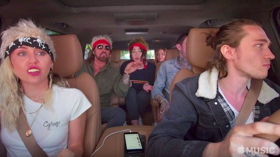 """The trailer for Miley Cyrus' 'Carpool Karaoke' looks like total chaos  Carpool Karaoke with the Cyrus family looks set to be every bit as chaotic as you'd imagine.  In the preview above a full seven members of the Cyrus clan  including Miley in the passenger seat  don matching headgear for a sing along of Billy Ray's """"Achy Breaky Heart"""".  SEE ALSO: John Legend sings about erections in hilarious 'Carpool Karaoke' clip  Seven people in one car is going to make for one hell of a hectic episode…"""