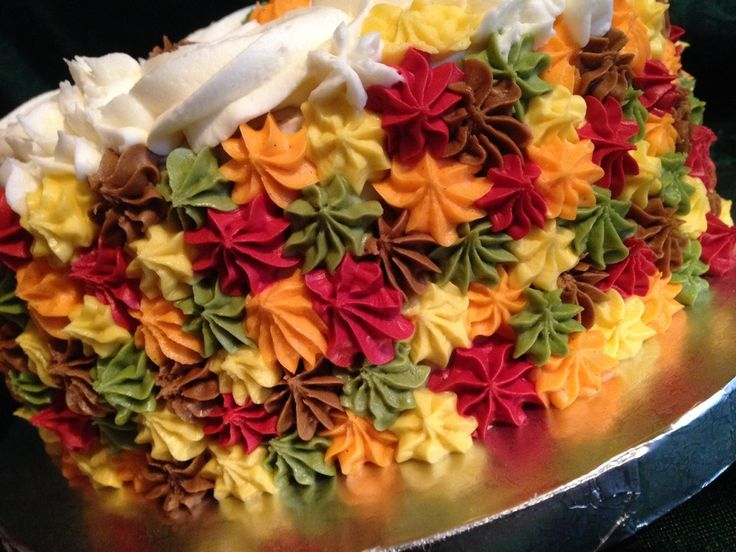 Fall themed cake - these colors but rosettes and on the sides only