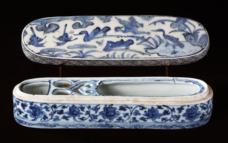 This pen case is a model example of the exchange of artistic ideas and influences between the Far and Middle East. Blue underglaze painting was originally a Persian invention that was adopted in the 14th century by the Chinese, who then dominated the field entirely with their blue and white porcelain. The pen case's shape is Islamic, modeled on metal cases, which the Chinese copied in porcelain for export to the Middle East. The base was made in China in around 1500 in the style of the day…
