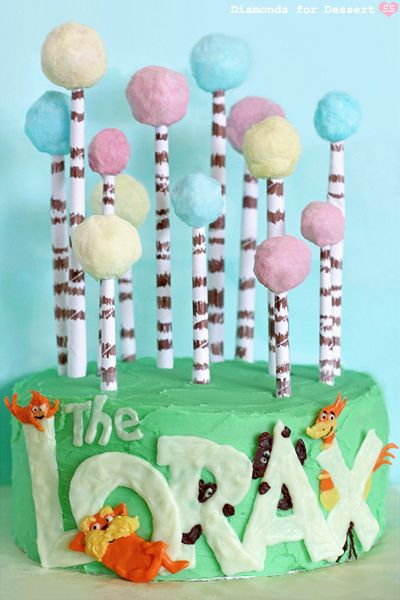 3/11/2012 The Lorax Cake.....so cute!  I would do a mini version for the kids lunch box and use a pirouette cookie with a ball of cotton candy on top =) --Leila