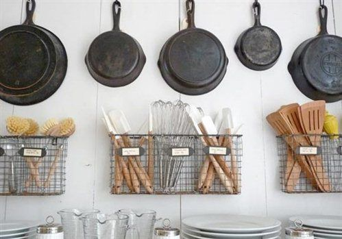 Another great idea for maximizing kitchen storage is as basic as a nail and hook. If you are challenged with drawer and cabinet space, there is no shame in hanging pans. I also happen to think these wire baskets are so chic. To me, merchandising a kitchen to look like a store brings me joy.