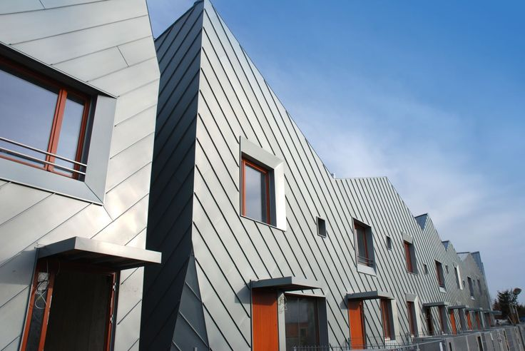 MikMak Houses by arc2 Fabryka Projektowa, Wroclaw, Poland. Facades clad with angled standing seam titanium zinc sheet steel named prePATINA blaugrau produced by RHEINZINK