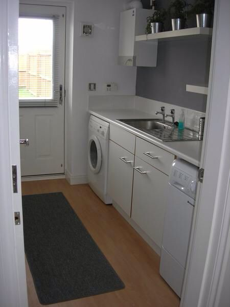 Utility with door leading out to back garden