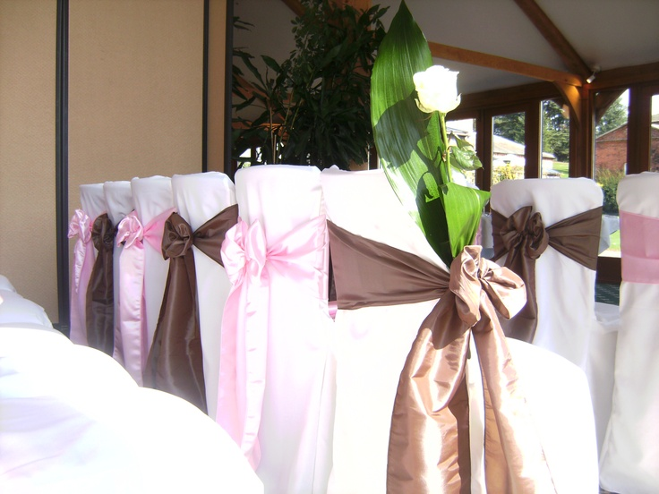 Alternating Baby Pink and Mocha Satin Bows on White Chair Covers