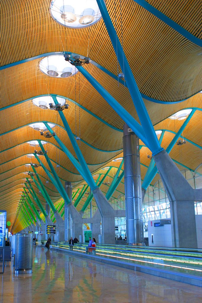 Madrid Barajas Airport Greg and I have been here! Coolest airport ever-the pillars in every terminal are a different color.
