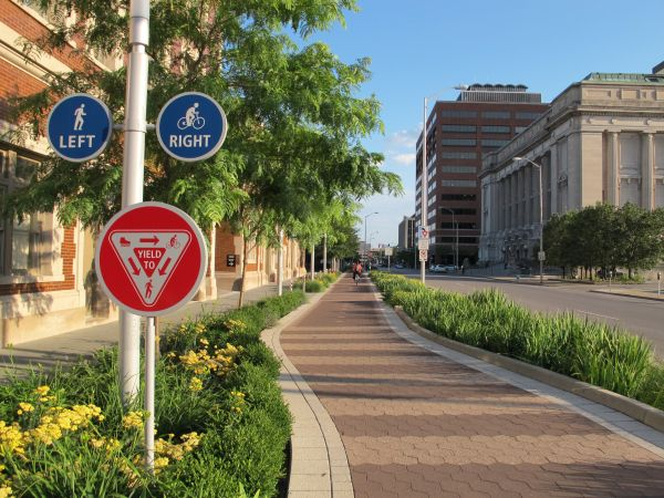 The Indianapolis Cultural Trail uses bioswales (landscape elements designed to remove silt and pollution from surface runoff water) as buffers between the cycle track and street. Click image for source, and visit the slowottawa.ca boards >> http://www.pinterest.com/slowottawa