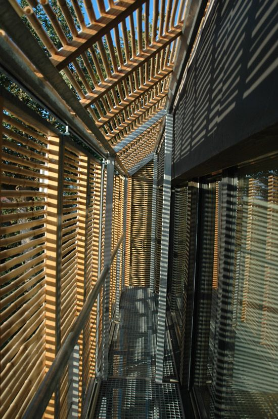 """This solar passive house in France by Karawitz Architecture boasts a """"second skin"""" of bamboo screens on steel frame"""