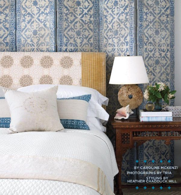 Layered textures make this space feel more cozy than cold. In a guest bedroom, an antique bedside table adds to the worldly sense of style. I love the mix of patterns!