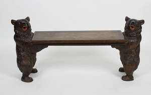 LOT:817 | An unusual Black Forest carved wooden bench