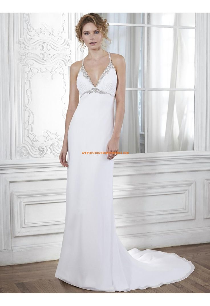 Lovely Sophistication is found in this elegant sheath dress constructed of Paris chiffon and accented with twinkling Swarovski crystals along the plunging