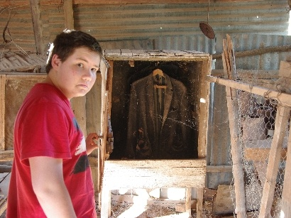 An old miner's wardrobe. The coat is still hanging there after years of exposure to the heat and the dust