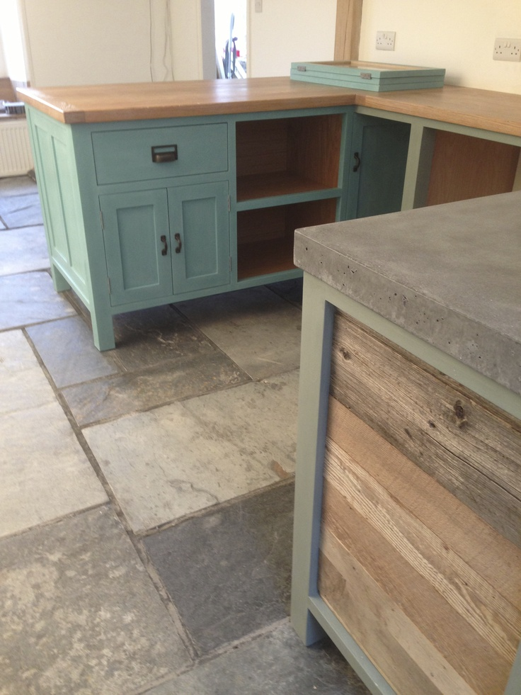 Cornwall kitchen with reclaimed timber panelling concrete and oak worktops.