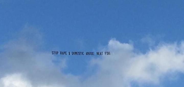 Plane banner ad flown over FSU vs Miami game with subliminal message mocking Jamies Winston (Photo @jotagraphs on Twitter)
