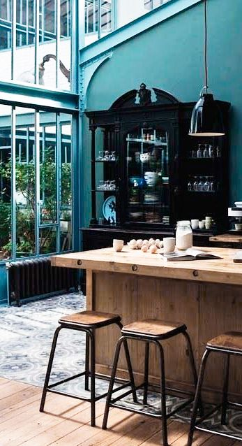 = teal, black and wood kitchen and Caravaggio pendant