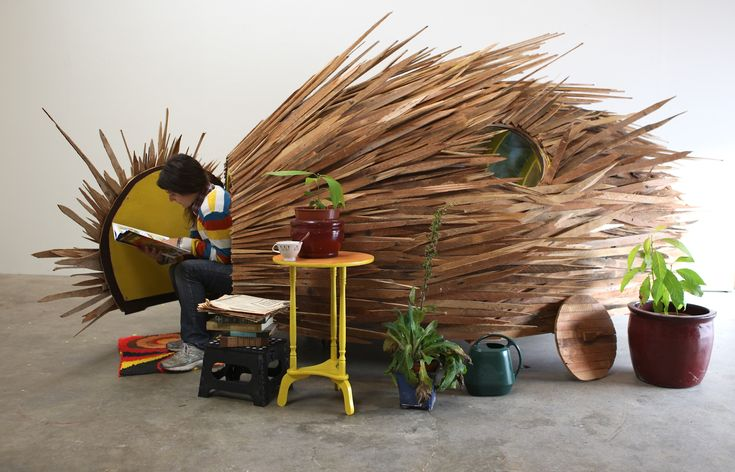 Sleeper Cells: A Cluster of Porcupine-Esque Huts Made from Found Wood