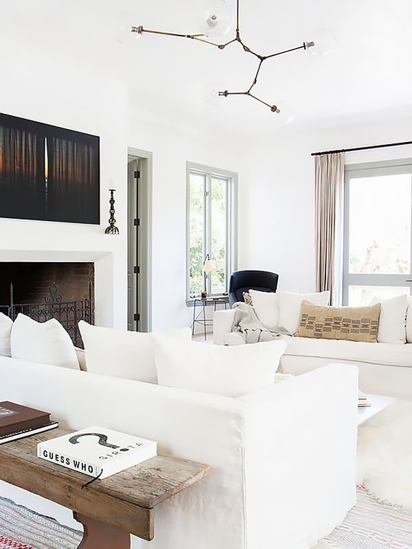 Rustic Inspired Living Room With White Linen Sofas And An Industrial Pendant Light