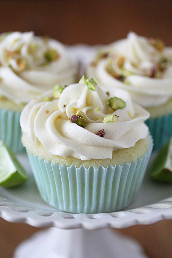 Key Lime Cupcakes topped with DELICIOUS White Chocolate Frosting & Salted Pistachios. #cupcake recipes...x