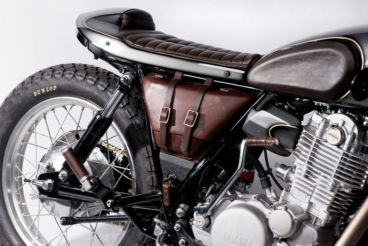 Add a leather saddlebag in place of the plastic shielding. Add it to the list for the Honder.