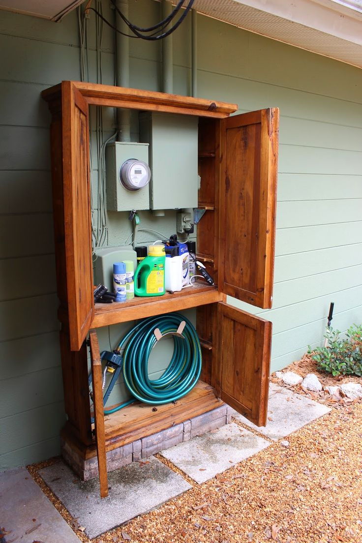 Utility Armoire - **CHECK LEGALITY in your area before proceeding !! and !! NEVER !! lock out the meter reader, obviously** - These clever homeowners repurposed a $20 yard sale purchase to hide their utility meters/hookups AND gained some attractive storage space in the bargain. (tutorial Shabby Glam blog)