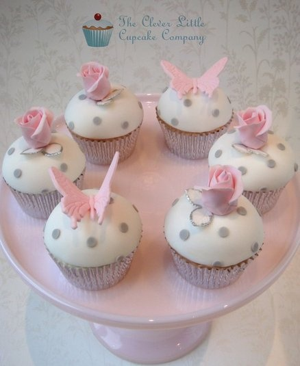 pink and gray polka dot cupcakes with roses and butterflies