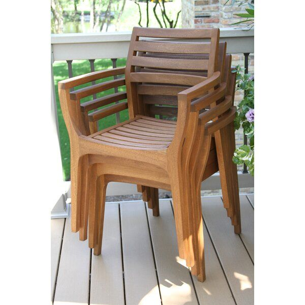 Bring Classic Coastal Style To Your Outdoor Ensemble With This Stackable Patio Dining Chair Crafted Outdoor Chairs Wood Patio Furniture Patio Furniture Sets