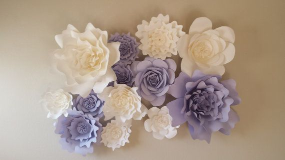 3D handcrafted beautiful paper flower set of twelve (12) in white and light purple, orchid. Includes: Three (3) 18-20 inch diameter flower Four (4) 11-16 inch diameter flowers Five (5) 6-10 inch diameter flowers *various shape styles like picture unless otherwise noted by buyer.  Perfect romantic whimsical backdrop for a wedding, bridal or baby shower, nursery, and even for home decor!  Each petal is meticulously handcrafted from high quality heavy weight cardstock. The flowers can be custom…