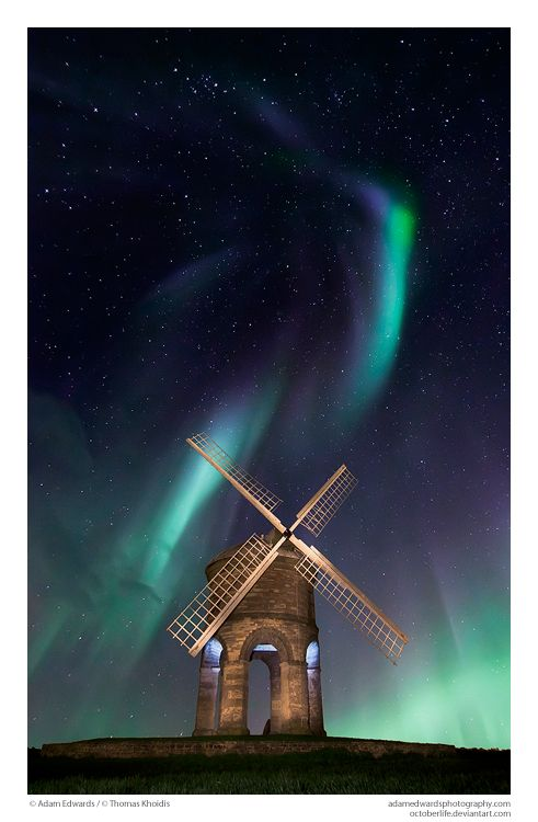 Absolutely stunning photography. Aurora borealis and a windmill.