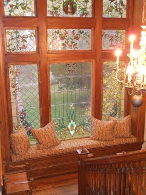 Gorgeous stained glass windows with window seat. WOW