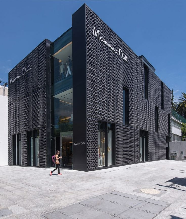 A patchwork of patterned, fibreglass panels wraps the exterior of this three-storey boutique for fashion brand Massimo Dutti