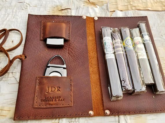 Large Leather Cigar Case w/ Field Notes Book * Soft yet durable, fits great in a sport bag, suitcase, backpack, travel bag, protect your investments * Holds 10-12 standard cigars in a humidor bags, split between both sides * Quite versital and could be used to carry 1 or 2 pipes