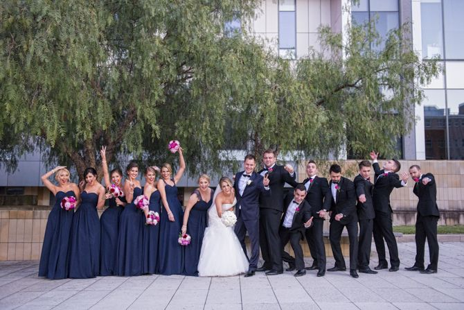 Bridal party having fun on location #markjayphotography #sydneyweddingphotographer #weddingphotography #bridalparty #pose #style #bride #bridesmaid #groomsmen #navy #pink
