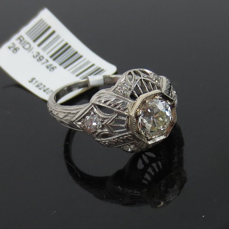 Presented for sale is a rare JE Caldwell & Co Old mine cut diamond platinum ring. This ring is finely crafted in platinum, it features beautiful hand carving in the platinum as well as old diamond accents on the sides. | eBay!