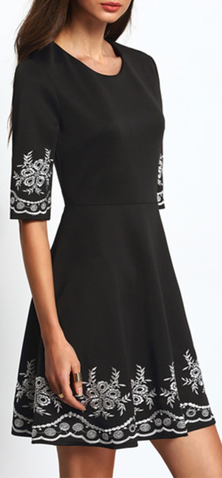 Black Half Sleeve Embroidered Flare Dress. absolutely gorgeous dress. i wore it to a formal event and received so many compliments. the material is also very nice, kind of thick and smooth. recommended