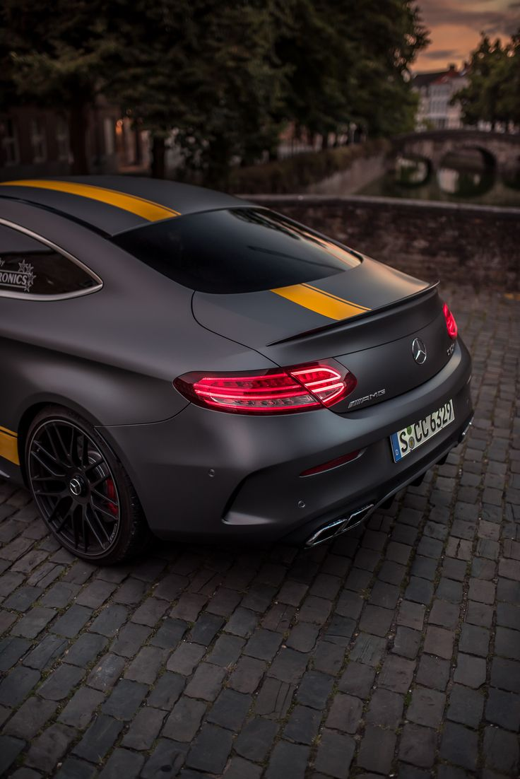 Fierce look: This Mercedes-AMG C 63 comes with a matt finish and yellow contrasting stripes. Photo by Mike Crawat for #MBsocialcar [Mercedes-AMG C 63 | Fuel consumption combined: 8.9-8.6 l/100km | combined CO₂ emissions: 209-200 g/km | http://mb4.me/efficiency_statement]