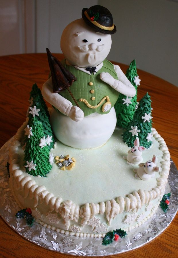 """From the TV special, Rudolph the Red Nosed Reindeer. About 16"""" tall from base to top of hat, the figure of Sam's body is made from cake, and his head is made of rice krispy treat, and it's all fondant covered, sitting on a base cake covered in buttercream. The details are made from fondant or gumpaste."""