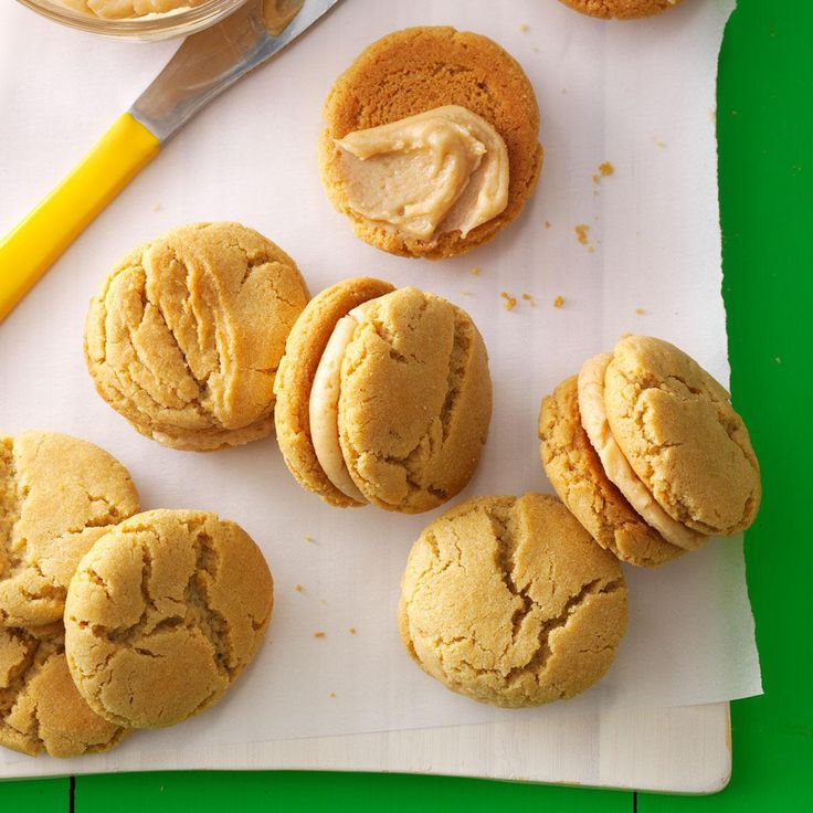 Peanut butter lovers go nuts for these rich little sandwich cookies. On a hot day, sandwich ice cream between the cookies instead of frosting. | Mini Peanut Butter Sandwich Cookies Recipe from Taste of Home