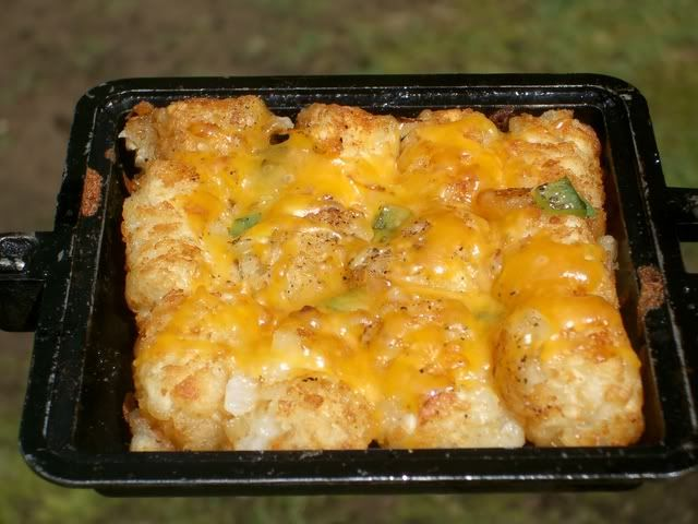PIE IRON CHEESY TOTS. You could serve these Cheesy Tots with an egg on top that was cooked in your Pie Iron by its self or right along with the Tots. Play with this recipe and make it your own using different cheeses and toppings.