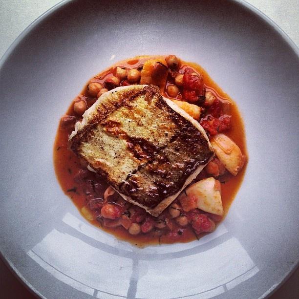 Cornish Haddock, chick pea, tomato, chorizo, spinach, squid