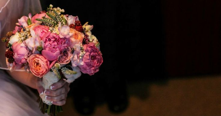 Details from a wedding bouquet of pink peonies and berries.  Photo credit: http://www.pinterest.com/tzutzu75/
