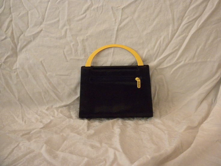 Black Jane Shilton.  Purchased at Harrod's in the 90s.  Metal handle folds in, has detachable shoulder strap.  Small.