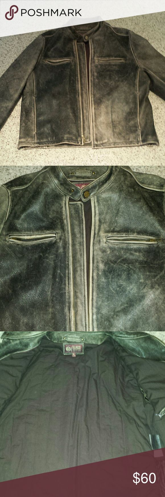 Men's leather bomber jacket Black and tan leather.  Zippers at wrists. Zipper up. Two zipper breast pockets. Snap at neck. Two waist pockets and an interior pocket. Good condition. Some marks on arm but not damaged. Wilsons Leather Jackets & Coats Bomber & Varsity