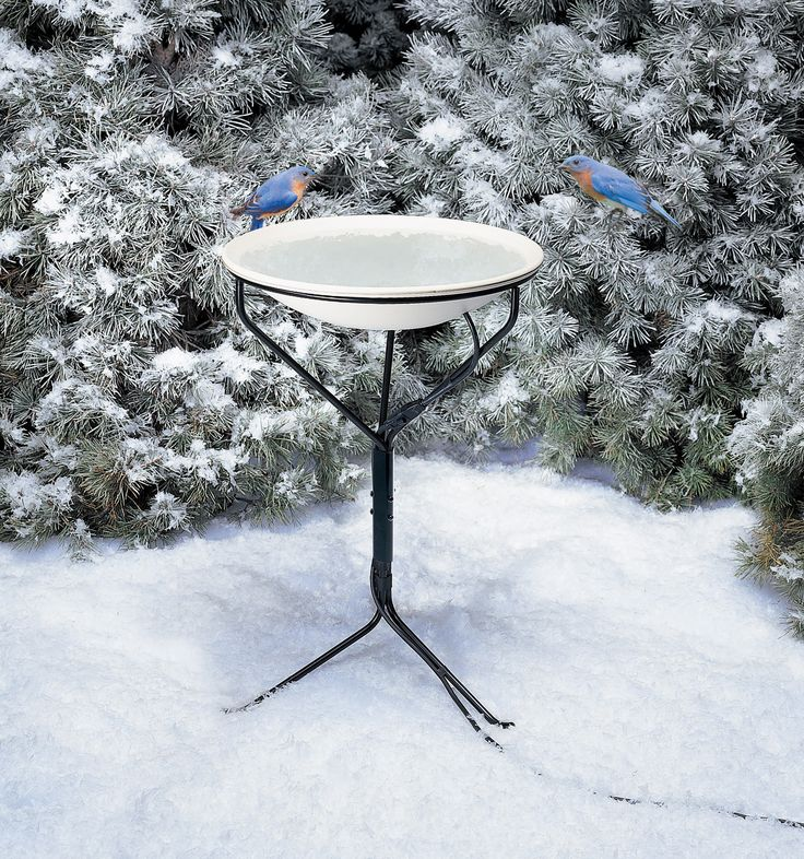 """970  Heated Bird Bath with Stand. 150W, 120V. Sturdy weather-proof Metal stand included. Ice free water in winter. Heating element is hidden. Built-in Auto thermostat. Mounts to wooden deck railings. Approx. size with stand is 21 X 3.5 X 20.5""""."""