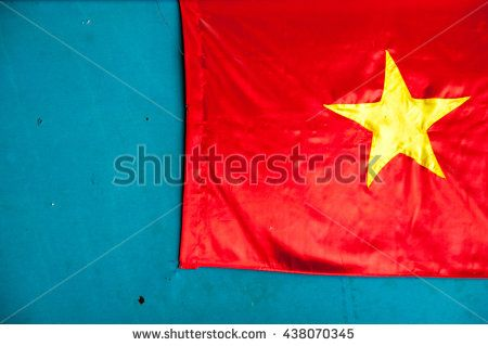 Vietnam Flag of satin fabric on a background of blue wall - stock photo