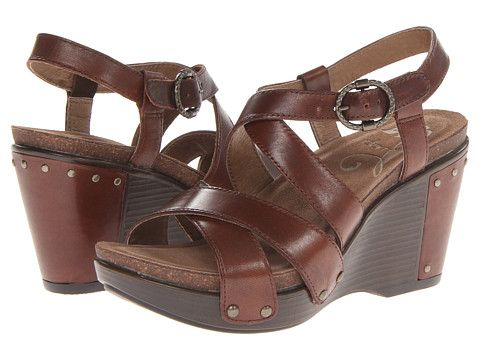 Dansko Frida Sandal SKU: #8256336 COLOR: BRANDY ANTIQUE FULL GRAIN LEATHER SIZE: 41 (US WOMEN'S 10.5-11) that can be bought at walking company or zappos. I bought these sandals in navy color! They are very stylish, the perfect wedge shoe for the season, comfortable to wear, and good for my feet. Great with maxi dresses, capris, and skirts.