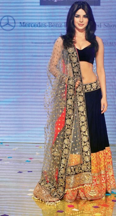 Priyanka Chopra in a black and orange Manish Malhotra lehenga