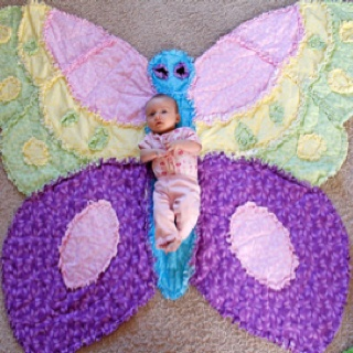$65.00 No no only selling the butterfly rag quilt, sweet Zoe is just giving you an idea on size.