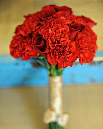 sweet bouquet of red carnations and roses