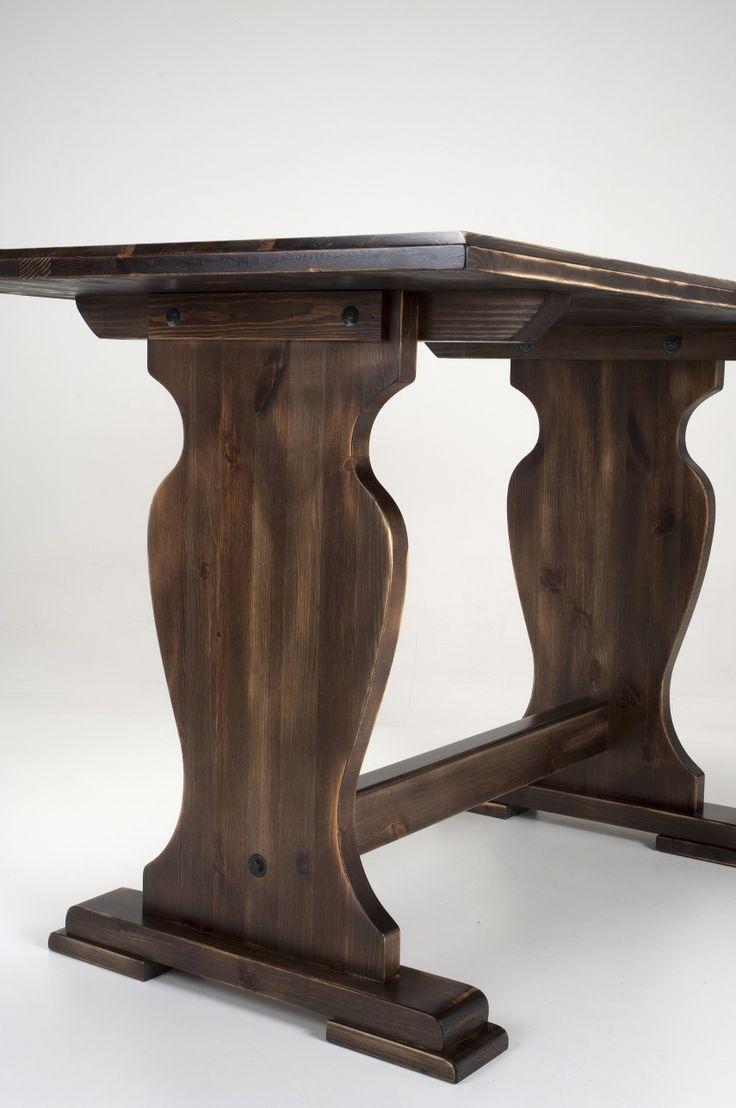 Table 200. Solid Swedish pine wood table with contoured sides, varnished with aged walnut wood.  Tavolo 200. Tavolo in legno di pino massello, con fianco sagomato e tinta noce invecchiata.