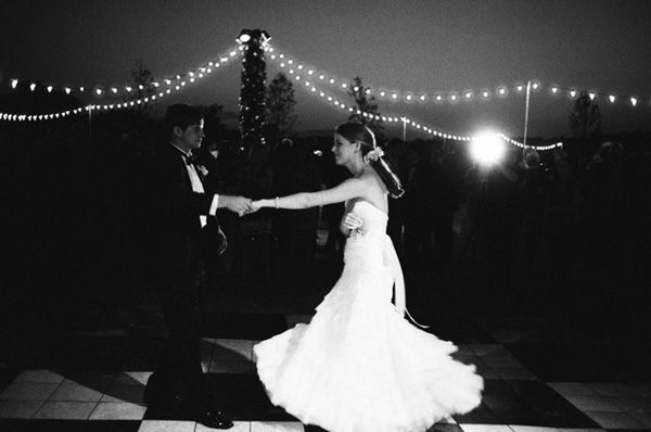 love the idea of twinkle lights draping from a central pole to light up the dance floor.